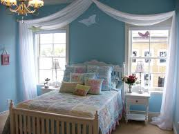 fancy bedroom idea with white curtains also light blue wall treatment