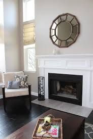Living Room Decoration Ideas Featuring Black Squared Iron Cast Fire Place  Cover And White