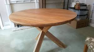 trinity natural solid oak round table with crossed legs and 4 x dining room chairs