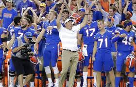 florida head coach dan mullen center celebrates with players on the sidelines during the final moments of an ncaa college football game against lsu