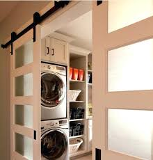 sliding barn door hardware with frosted glass material for timeless laundry room stacked washer dryer machine