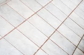 unsealed tile grout holds onto stains and dirt like a sponge