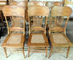 set of 6 tiger oak double pressed back chairs wide backs rope twist turned spindles and fluted side posts hip rests newly caned seats and carved