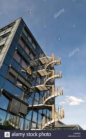 modern office architecture. Modern Office Architecture With Spiral Staircase, Glass Building, Metal External Blue Sky, Near Munich T