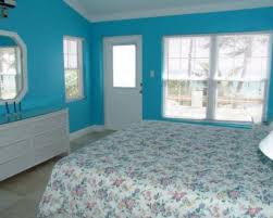 traditional blue bedroom designs. Lovely Light Blue Bedroom Color Design Combined Mixed With Bright White Transparent Vinyl Sliding Window And Flowering Bedcover Also Pure Traditional Designs R