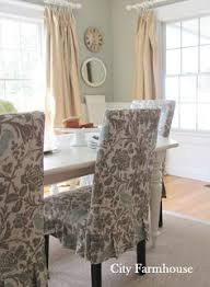 love the slip covered dining room chairs