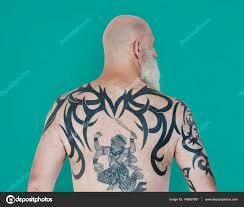 картинка тату на пояснице человек с тату на спине стоковое фото