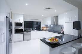modern kitchen black and white. German Style Modern Kitchen With White Cabinets And Black Counter Top
