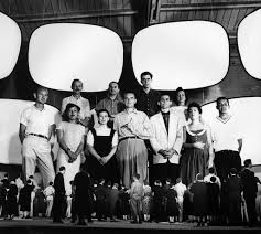 the eames office. the eames office staff with a model for glimpses of usa exhibition in moscow 1959 i