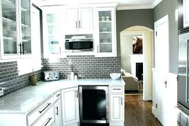 white grey backsplash grey white grey subway tile kitchen white cabinets black countertop grey backsplash
