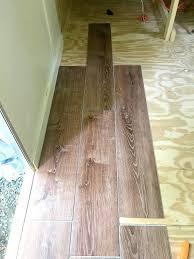 vinyl plank flooring laid out on plywood floor