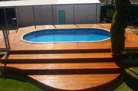 swimming pool wooden deck with steps of backyard oval above ground pertaining to wood decks for pools plans 9