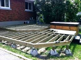floating deck over concrete post pads wood building a on top of patio