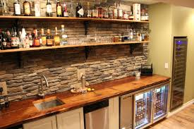 basement bar stone. walk up style wet bar featuring reclaimed rail car floor planks as shelves and stone back wall, stapleton neighborhood in denver. \u2039 \u203a basement i