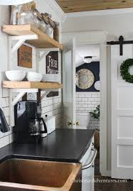 farmhouse kitchen with open shelving and leathered granite counter tops