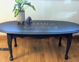 Plush, button tufted upholstery creates an elegant table top that allows this coffee table to double as an ottoman. French Coffee Table Etsy