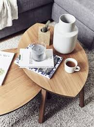 two coffee tables with decorative accessories stockholmikea ideasnesting tablese saving family roomsweet homelive modernliving roomworkplace design