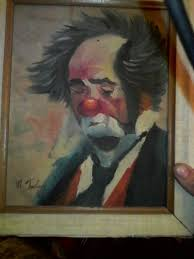 i have an old sad clown painting and i m trying to find out how much it is worth