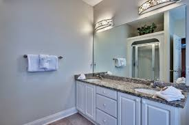 master bathroom with jacuzzi and granite countertop