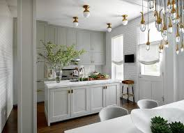 brass pulls kitchen. amazing gray kitchen features grey shaker cabinets adorned with antique brass inset hardware paired white marble countertops and a subway tiled pulls k