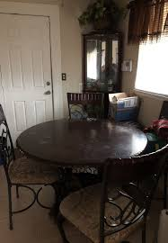 50 inch round table plus 4 chairs table needs polishing seat cushions clean very sy set will throw in the curio cabinet furniture in detroit mi