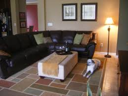 living room black leather sofa and rectangle white table on assorted color rug connected by