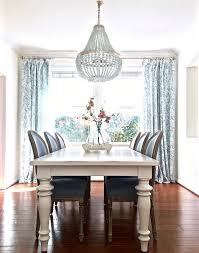 blue and white dining room with edisto white beaded chandelier s kristywicks