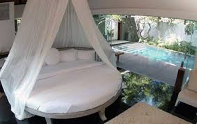 Perfect white bedsheets, and a perfect white canopy may be hard to maintain  - but