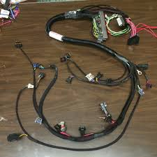 gm ls engine harnesses under the hood not a cut down harness brand new terminals crimped like factory brand new wires no ering joints fuse box included for as plug and play as possible