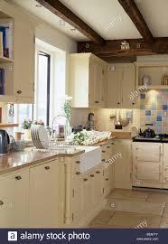 Cottage Kitchen Belfast Sink Below Window In Country Cottage Kitchen With Cream
