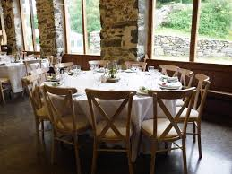a round six foot table in the big barn with our wedding chairs