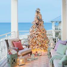 beach house decor coastal. christmas tree on porch in florida home via coastal living http beach house decor