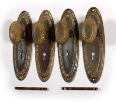 sold antique brass oval doorknob sets with plates leaf design