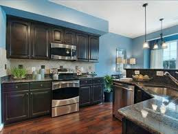 charming blue kitchen walls with brown cabinets