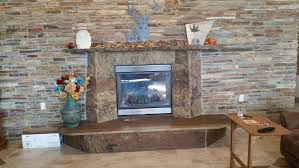 natural stone fireplace with cleft surround