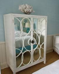 wood and mirrored furniture. mirrored cabinet with wooden frame painted white wood and furniture