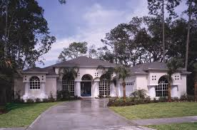 grand design with mimic arched windows and front entry