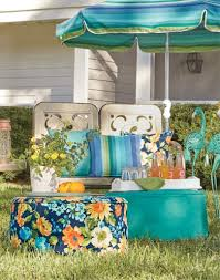 product category outdoor shot of fl and solid poufs and cushions around lawn furniture