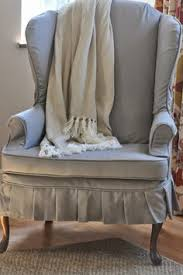 slipcover in outdoor fabric via nine and six home living room
