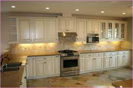 antiquing white kitchen cabinets distressed white kitchen cabinets painting kitchen cabinets white distressed white kitchen cabinets
