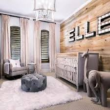 rustic nursery features an accent wall clad in planks lined with marquee light spelling out the name elle placed above a gray nailhead crib baby nursery rockers rustic