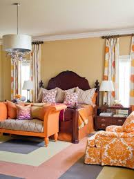 Large elegant master carpeted and multicolored floor bedroom photo in  Little Rock with beige walls