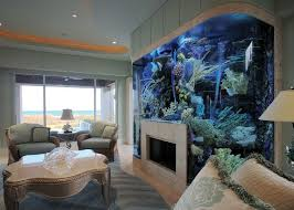 View in gallery Aquarium surrounding fireplace in living room