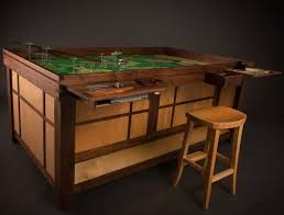 A lot of games require a lot of space and many tables just don't cut it for  the really elaborate table games. Over at Geek Chic though, you can be sure  to ...