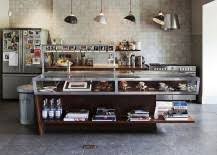 Since large loft-inspired kitchens with their giant industrial-style,  framed glass windows, double height ceilings and sweeping spaces so often  take center ...