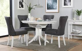 hudson round white extending dining table with 4 bewley slate chairs play arrow