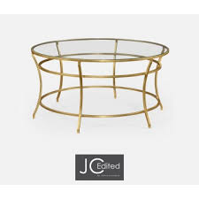 jonathan charles round coffee table gold leaf iron with a clear glass top