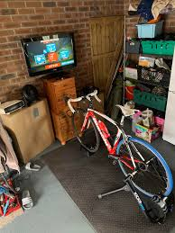 My pain cave got an upgrade after my sister donated her old tv to me. Using  this and my bedroom Apple TV has been revolutionary! : Zwift