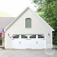 double carriage garage doors. This Pella Carriage House Series White Double Garage Door With Black Hardware Accents And Large Upper Doors A