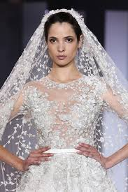 dress for winter wedding. paris, france - july 10: a model on the runway wearing wedding dress for winter